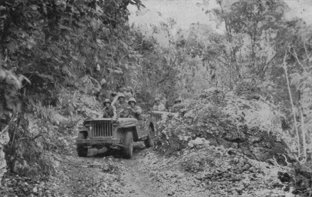 Marine jeeps bring supplies to the front on Saipan.