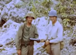 "Americans posing with a Japanese grenade launcher (""knee mortar"") recovered from the scene of the charge."