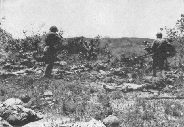 Marines of 2/2 cautiously move out to investigate the scene of the charge.