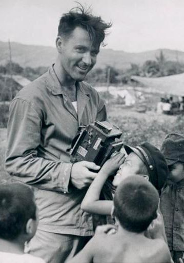 Stan Troutman shows off his camera for Japanese children on Saipan.