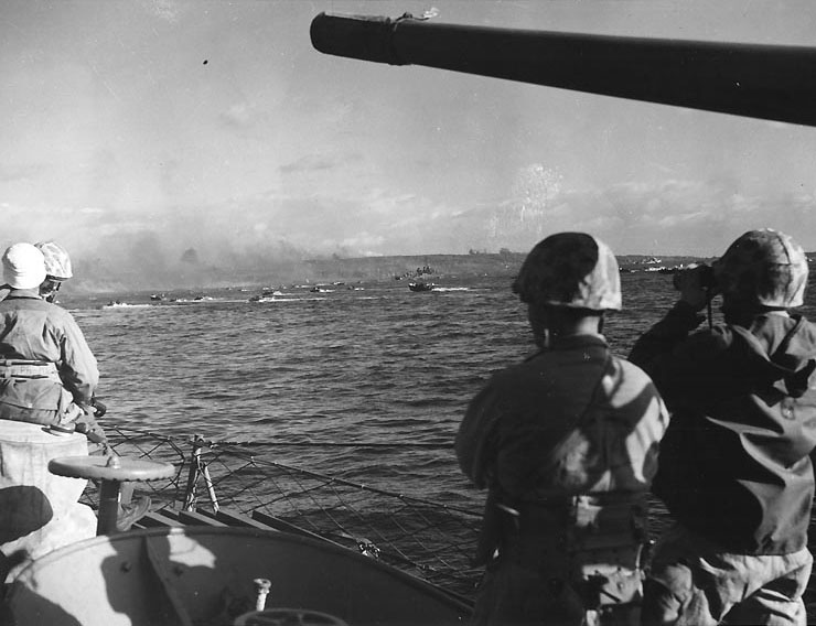 Fourth Division officers watch the landing waves,