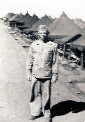 This might be Major Horace C. Parks. Parks was Charlie Company's first commanding officer, and Gilliam would have known him from earlier campaigning. In 1945, Parks was the battalion executive officer. (If this is Parks, it might suggest that this picture was taken towards the very end of the war, when restrictions on cameras were relaxed.)