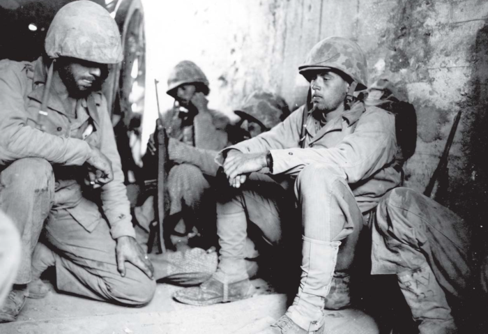 Business as usual. A Marine command group takes shelter in a Japanese blockhouse.