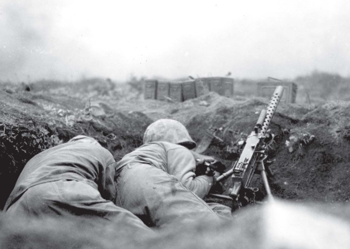Machine gunners take cover as mortar shells explode around them.