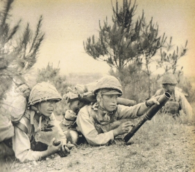 "Japanese troops with the Type 89 Grenade Launcher, commonly called a ""knee mortar."" Photo from dieselpunks.org"