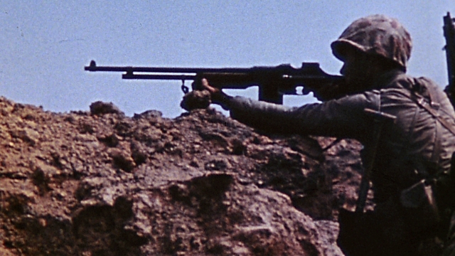 A Marine BARman takes careful aim. Still from USMC combat camera.