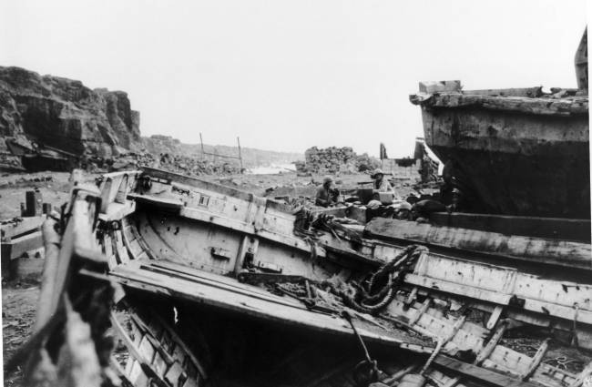 Marines explore around the wreckage of the Boat Basin.