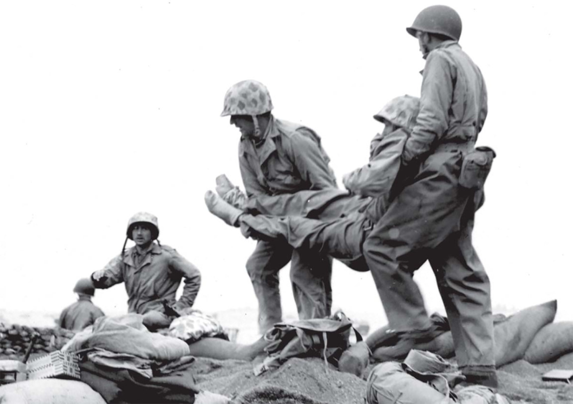 Bringing a wounded Marine back to safety. USMC photo.