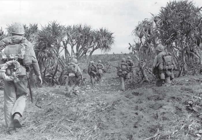 A heavily-armed Marine unit moves up to the front. USMC photo.