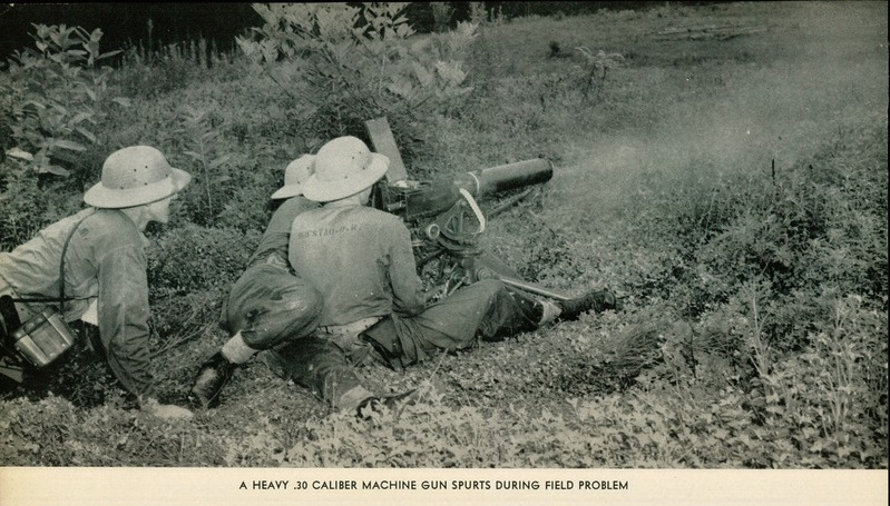 Candidates of the 12th Reserve Officer's Class (Phil's) fire a Browning M1917 machine gun during a field problem at Quantico, 1942.