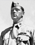A stern-faced Captain Eddy wears the Navy Cross earned on Iwo Jima.