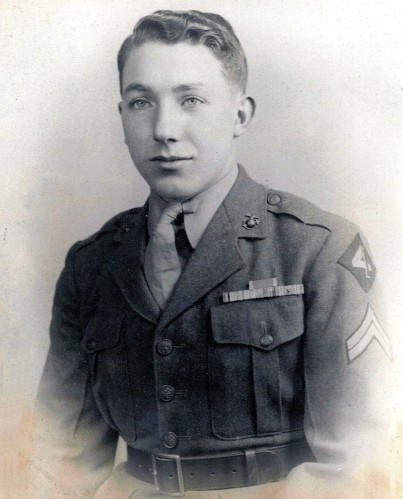 Corporal Husner sits for a portrait in 1945, ribbons on display. Photo from Ancestry.com family tree.