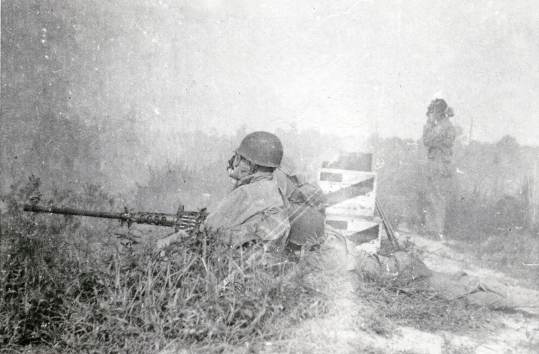 "Although they were considered ""rear echelon"" troops, the Motor Transport men had to know how to fight. Here, a team mans a .50 caliber M2 machine gun."