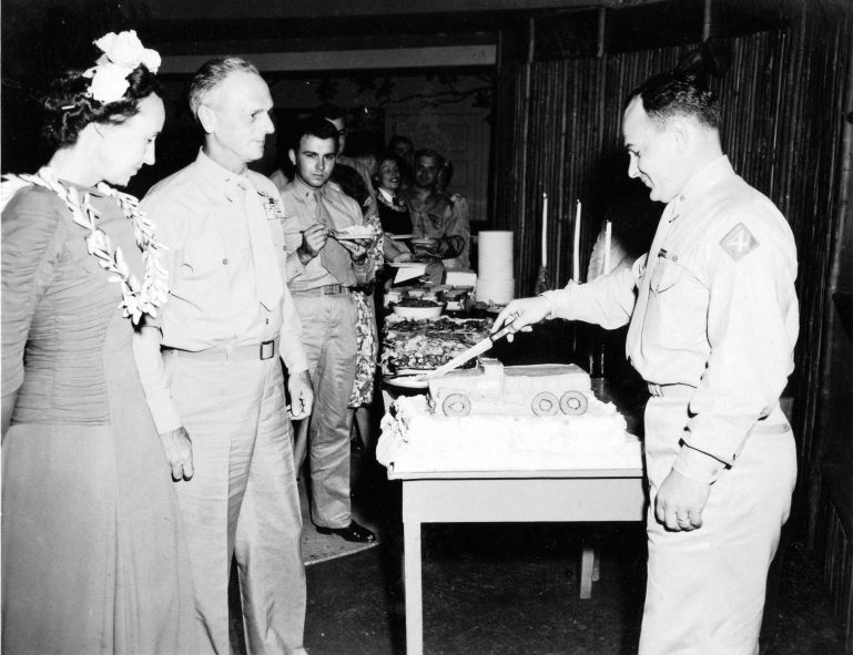 General Franklin Hart, the assistant division commander, watches Major Danneker slice a Motor-T cake.