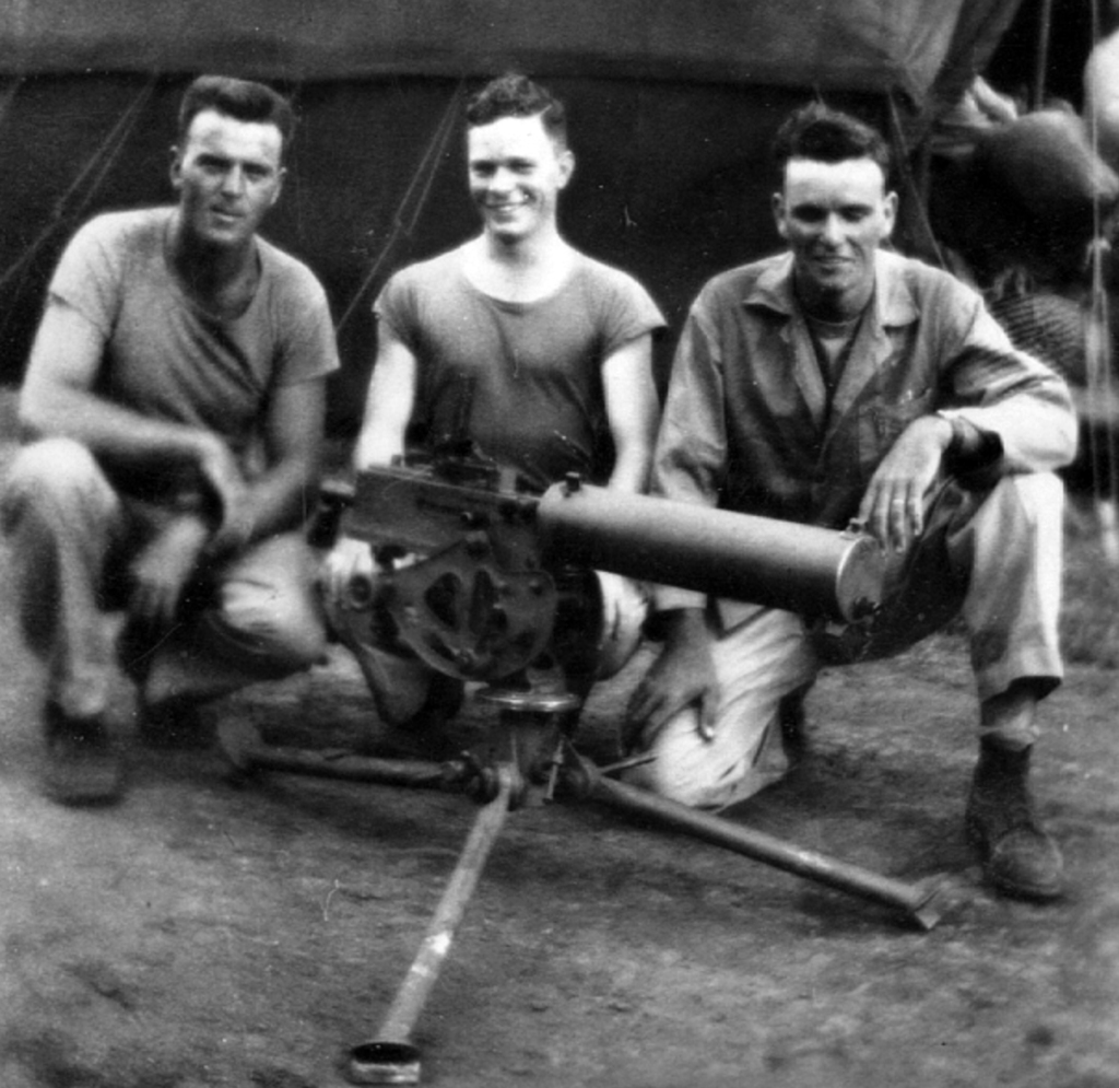 """Pop"" Johnson, ""GI"", and Thomas Jones with their squad's heavy M1917 machine gun."