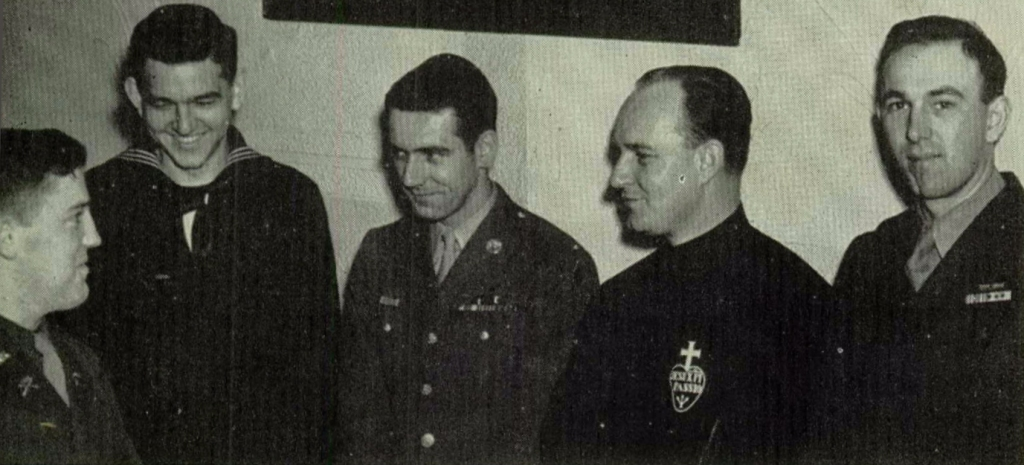 Paul Geckle (left) visits with Father Lambert and other graduates of Mount St. Joseph High School, 1945.