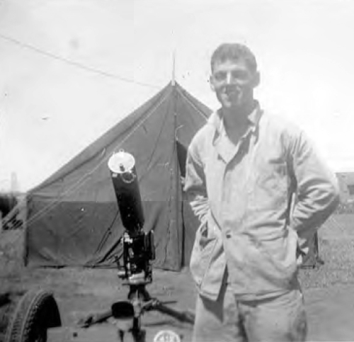 George McKenna at Camp Maui, 1945. He stands beside his squad's M1917 Browning machine gun. Photo courtesy of Joseph Baranoski.