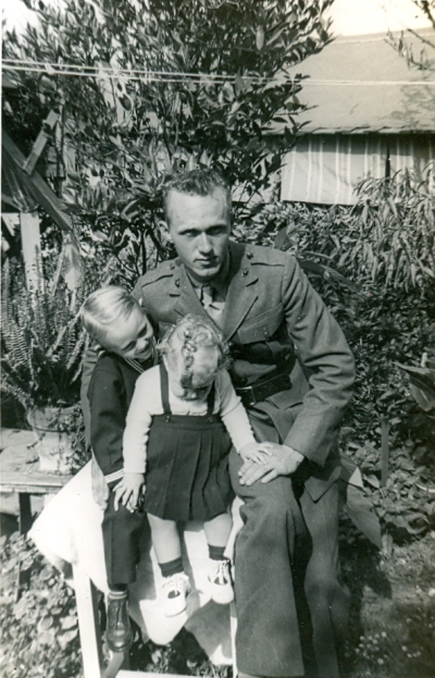 Herman Mooney with his children, Danny and Joyce, circa 1944. Photo found on Ancestry.com