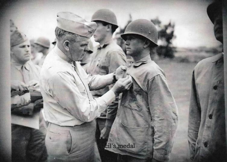 Cecil Hendershot receives his Purple Heart medal from Major General Harry Schmidt, commander of the Fourth Marine Division. This is likely his first Purple Heart, for arm and shoulder wounds received on Roi-Namur. Photograph courtesy of Cheryl Knight-Murphy Hendershot.