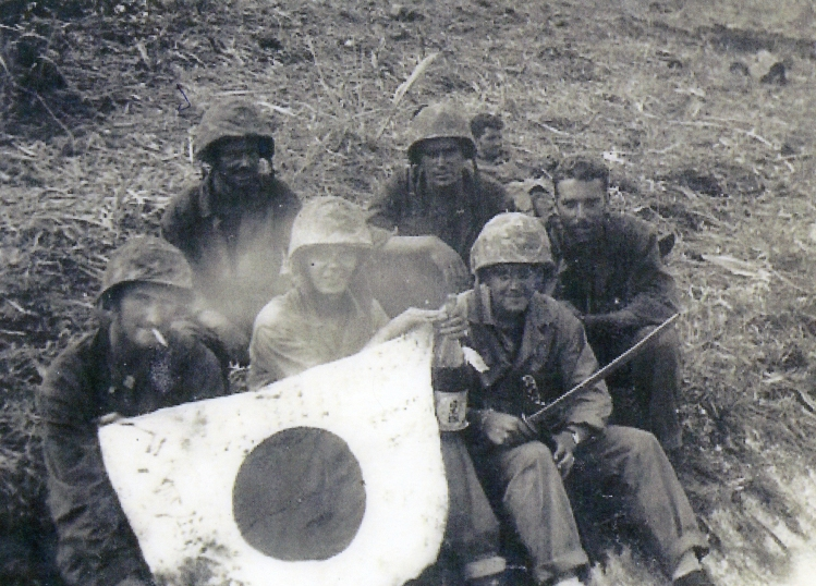 John Pope, almost unrecognizable after three weeks on Saipan, with buddies after the battle.