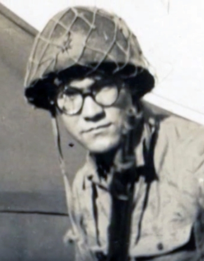 Jim Chavers models a Japanese soldier's uniform, helmet, and glasses–souvenirs of Iwo Jima.