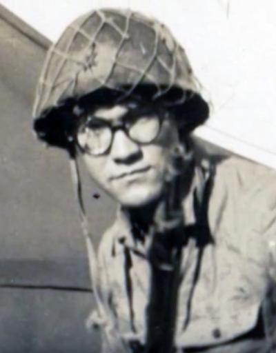 Jim Chavers models a Japanese soldier's uniform, helmet, and glasses–souvenirs of Iwo Jima.