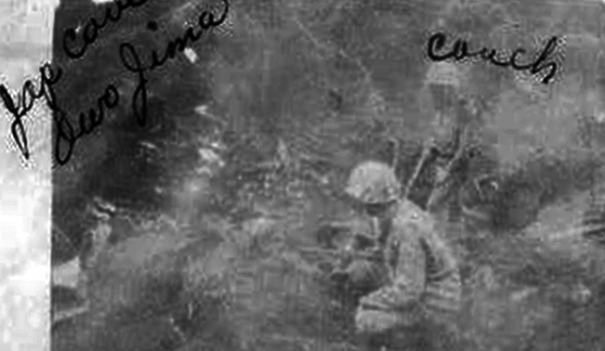 George Couch and Raymond Proulx investigate a cave on Iwo Jima.