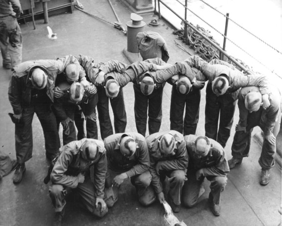 "Fourth Marine Division troops display the ""gung-ho"" spirit en route to the Marshall Islands."