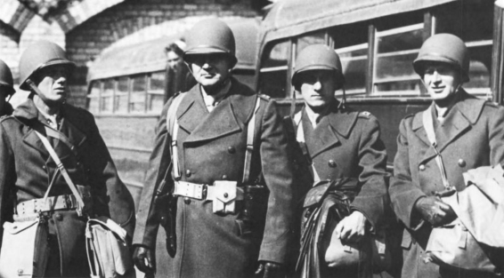 "Captain Martincheck, third from left, arrives in Londonderry, Ireland in 1942.  Photo from ""A Different War: Marines in Europe and North Africa."""