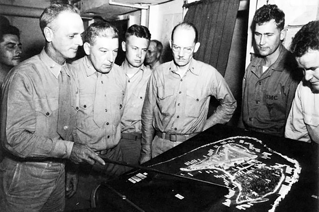 Officers of the 24th Marines inspect a relief map of Roi-Namur. Regimental commander Colonel Franklin Hart is at left; Jimmie Dyess is at far right. Beside him is the battalion executive officer, Major Maynard Schultz.