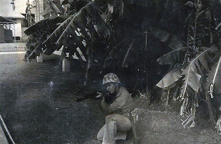 An unidentified Marine strikes a combat pose.