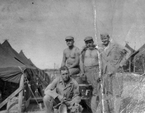 A&D men at Camp Maui. Squad leader Sgt. Harlan Jeffery is kneeling; the rest, from left, are PFCs Phil Mozdzer, Bill Deshong, and Phil Scally.