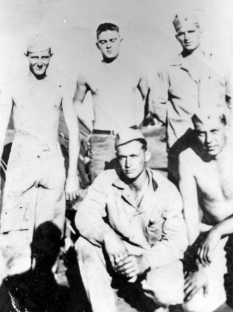 A squad of machine gunners from Company C. Standing: Frank Zebley, Harold Bowman, Sandy Ball. Kneeling, Art LaPorte, Harvey Williams.