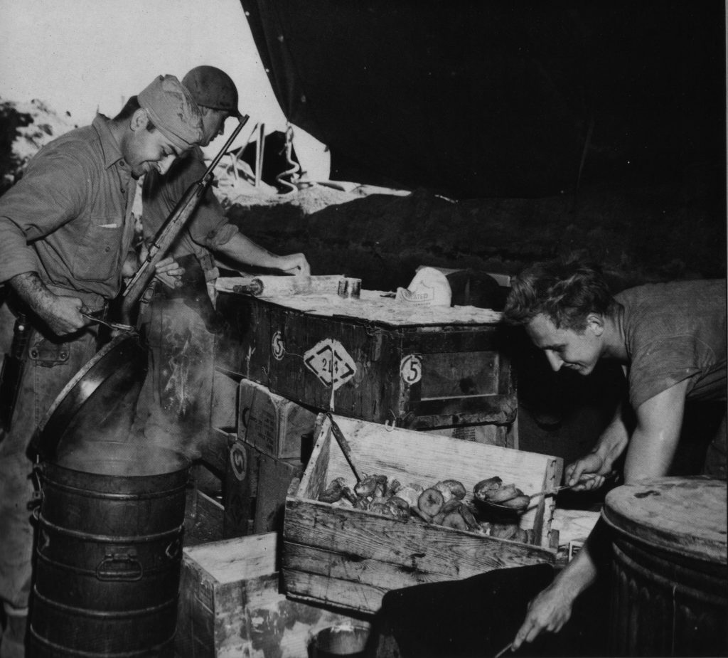 A Fourth Marine Division unit makes donuts in a makeshift kitchen on Iwo Jima. Date unknown.