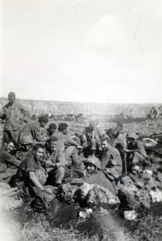 A large crowd gathers in a mortar pit.