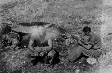 """Lt. Beehner, our platoon leader."" Beehner seems to have inherited command after the original platoon leaders, Lts Waldo Lincoln and James Donovan, were wounded and killed respectively. Reilly concentrates on his rifle."