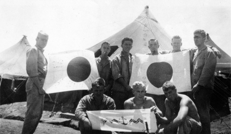 Showing off the spoils of war at Camp Maui in the spring of 1944. Most of these men belong to the 81mm mortar platoon.