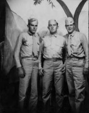 Three more Marines pose for a souvenir photo.