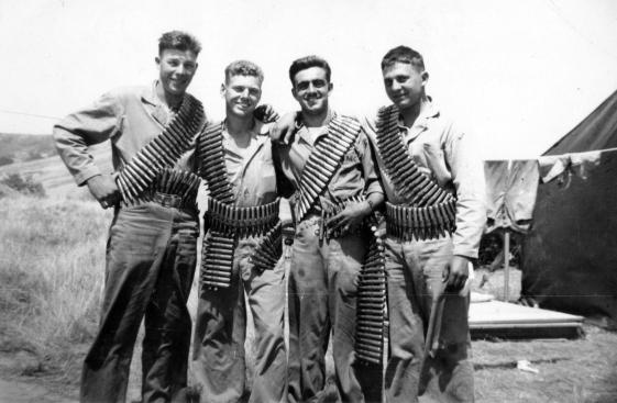 "The .50 cal machine gun outfit of the 24th Marines. Chuck [Podolski], me [Pope], Blackie [Poggioli] and Pinkey. Camp Pendleton."""