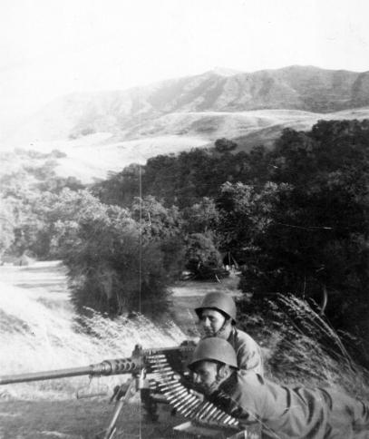 """Pinkey & me."" Pinkerton on the gun, Pope assistant gunner. 1943"