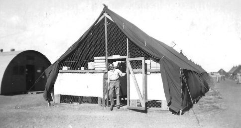 "A battalion surgeon. ""My supply tent, myself and on the left sick bay.  Pretty Stateside don't think - but a hell of a ways from it."""