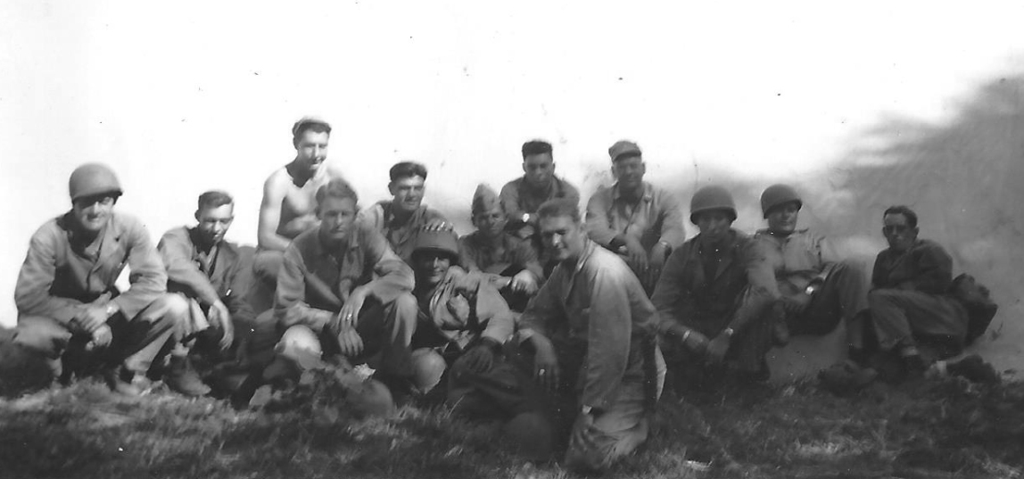 Group photograph, date and location unknown. Klauss is believed to be in the back row at left.