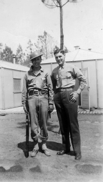 Bill with a buddy. The pasteboard huts suggest this may be New River, North Carolina.