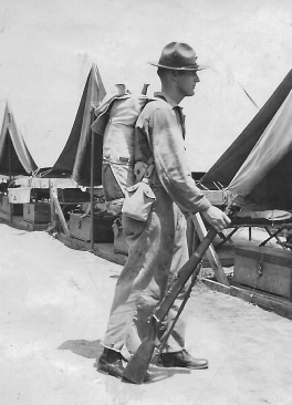 Displaying the combat gear of the early 1940s. Note the M1903 Springfield rifle.