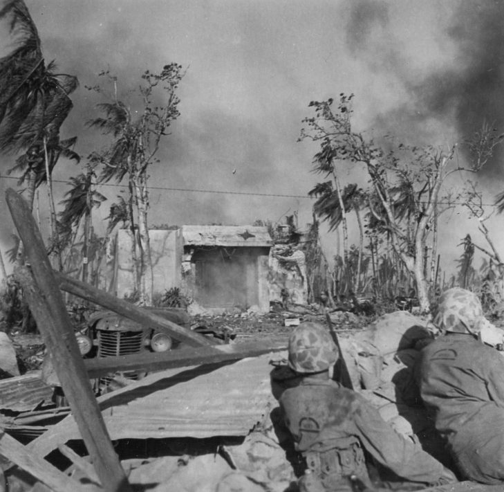 Marines from HQ Company, 24th Marines (note UNIS mark) stake out the blockhouse.