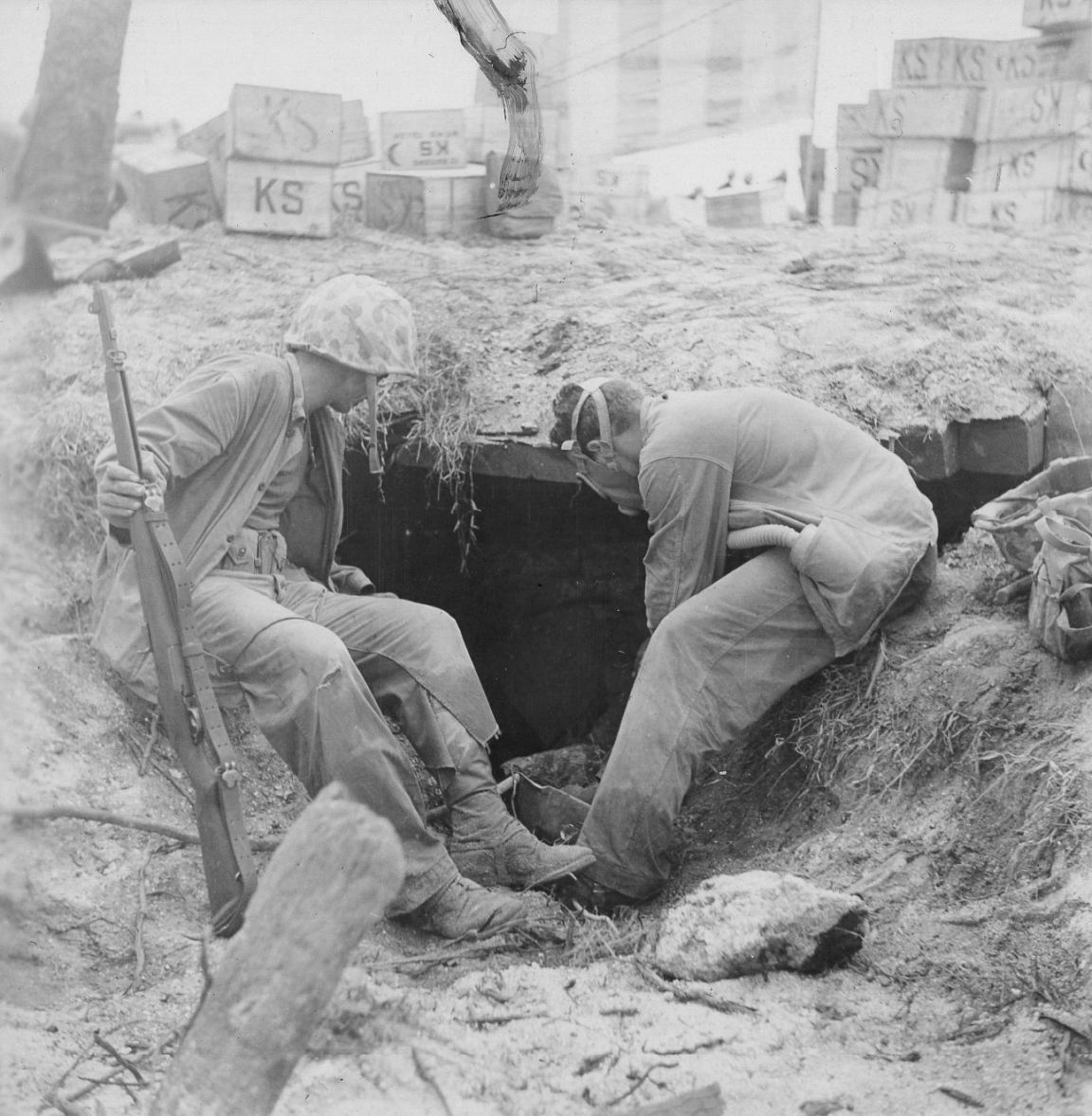 Searching for bodies on Namur. Note gas mask worn by Marine at right.