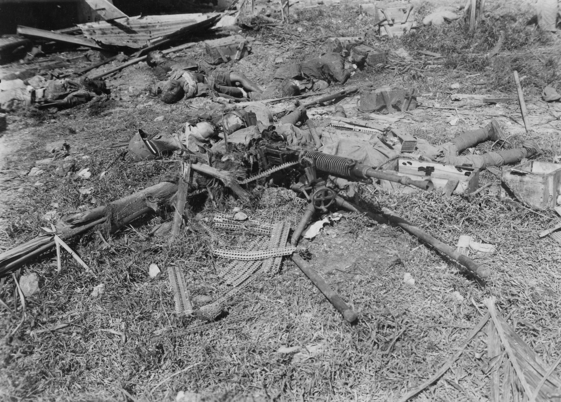 The remains of a Japanese machine gun team. Empty clips indicate that these men went down fighting.