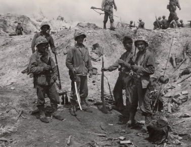 Swords, rifles, and beer were the souvenirs of choice for this group, possibly a comms team from 1/24.