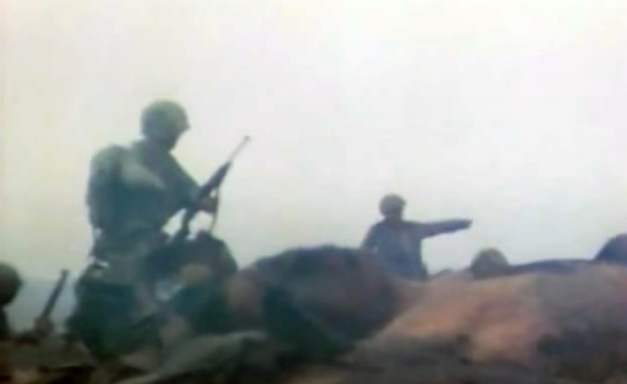 Scouting the way ahead in the morning haze. Still from USMC combat camera footage.