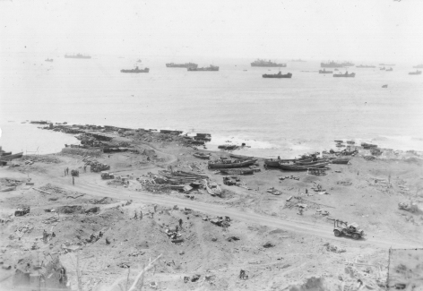 "Looking down on Iwo's ""boat basin."" First Battalion, 24th Marines faced hard fighting here in the early part of the campaign."
